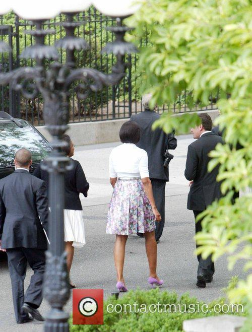 Michelle Obama and staff walking back to the...