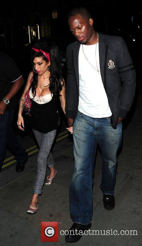 Amy Winehouse arriving at Bungalow 8 with a...