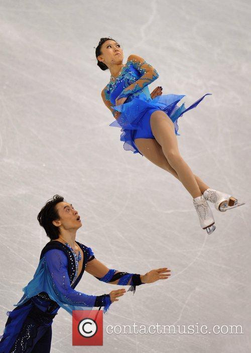 China's Ping Qing (top)/Tong Jian perform during the...