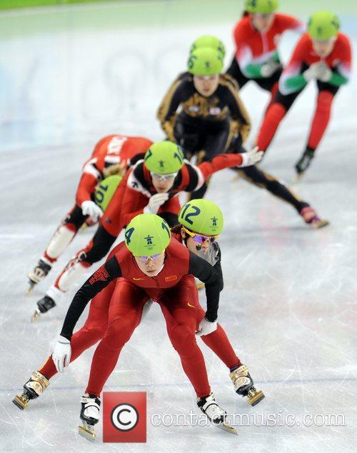 China's Wang Meng (L, Behind) and Zhou Yang...