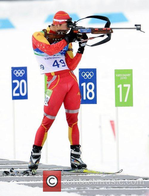 China's Zhang Chengye shoots during the men's 10km...
