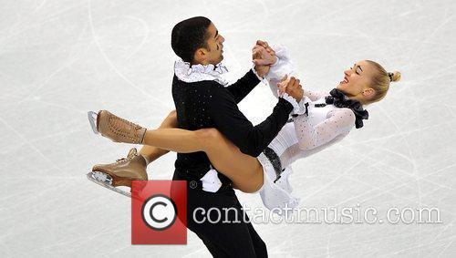 Germany's Aliona Savchenko (R)/Robin Szolkowy perform during the...