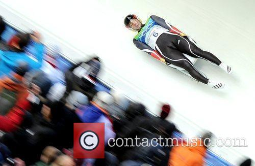 Germany's David Moeller competes during the men's singles...