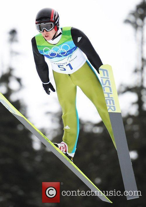 Switzerland's Simon Ammann competes for men's NH individual...