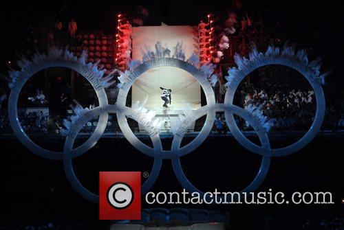 Atmosphere - A snowboard athlete jumps through the...