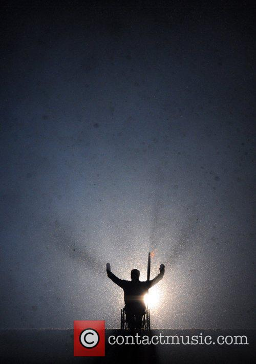 Atmosphere - A torchbearer is silhouetted The Opening...