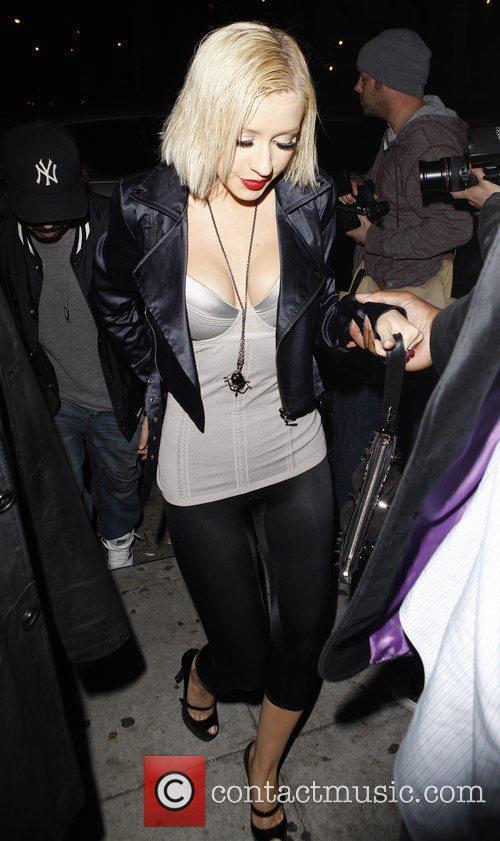 Attends a Grammy party at Wonderland nightclub