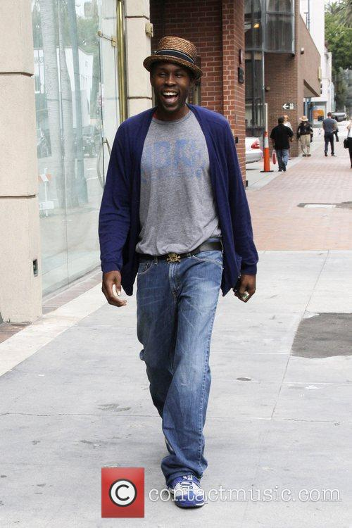 Wood Harris  leaving a bank in Beverly...