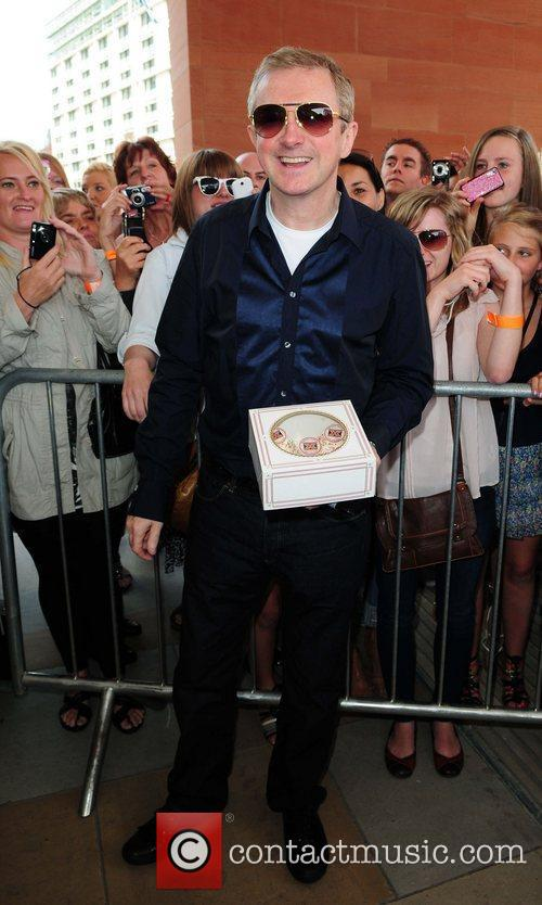 Carrying a cake as he arrives at The...