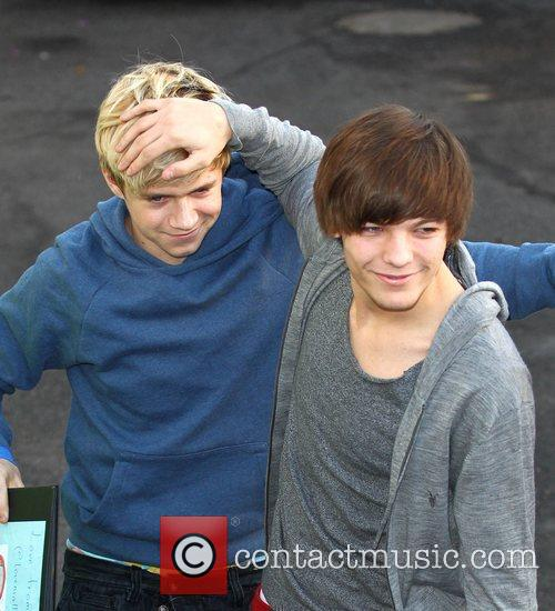 Niall Horan and Louis Tomlinson of One Direction...