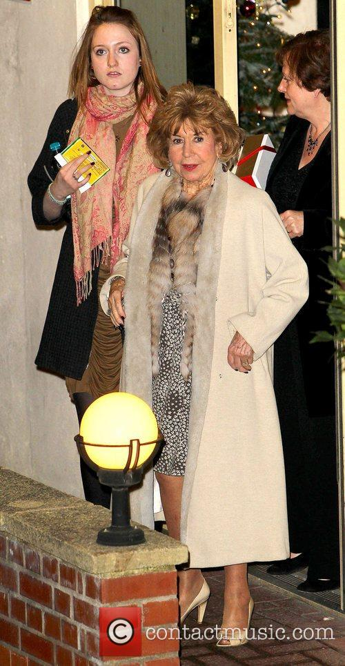 Julie Cowell, Simon Cowell's mother, leaves the studio...