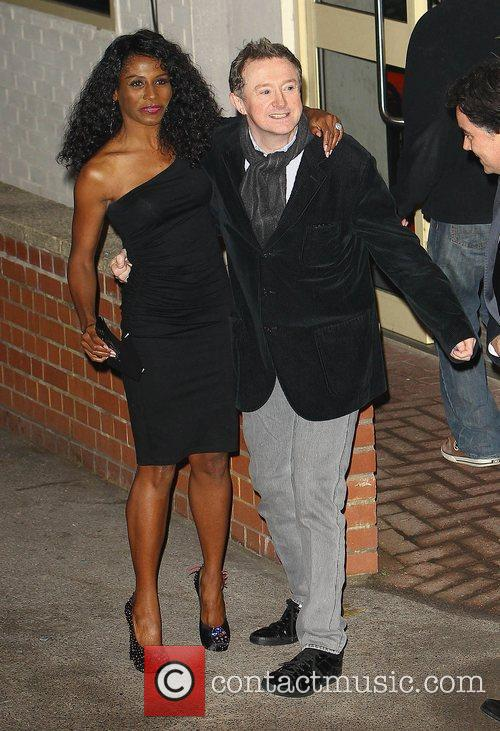 Sinitta and Louis Walsh leave the studio after...
