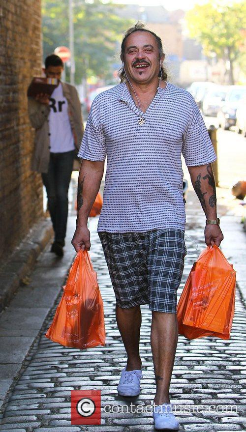 X Factor contestant Wagner Carrilho leaves the supermarket...