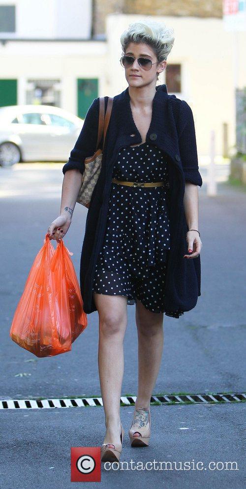 X Factor contestant Katie Waissel leaves the supermarket...