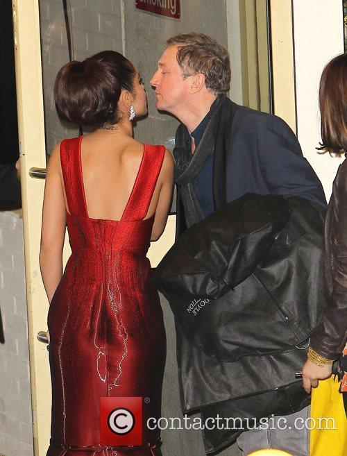Cheryl Cole kisses Louis Walsh as they leave...