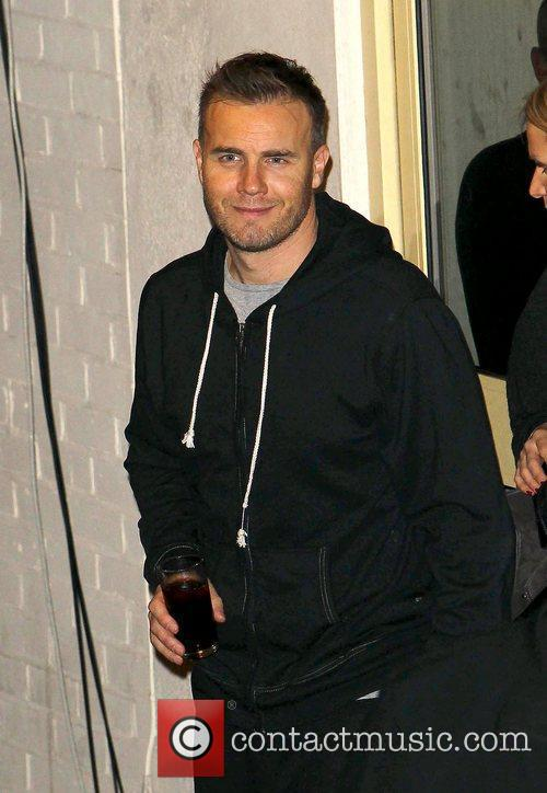 Gary Barlow of Take That leave the studio...