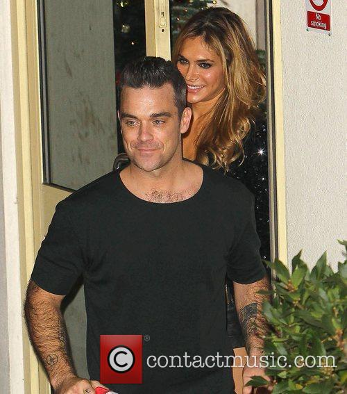 Robbie Williams of Take That and wife Ayda...
