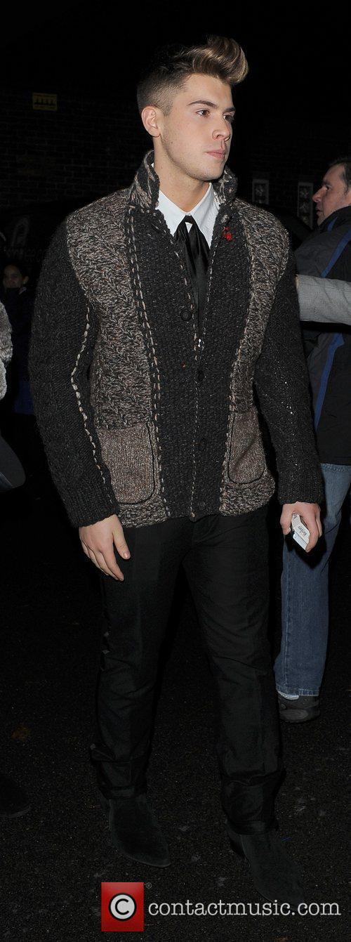 X Factor finalist Aiden Grimshaw leaving a recording...