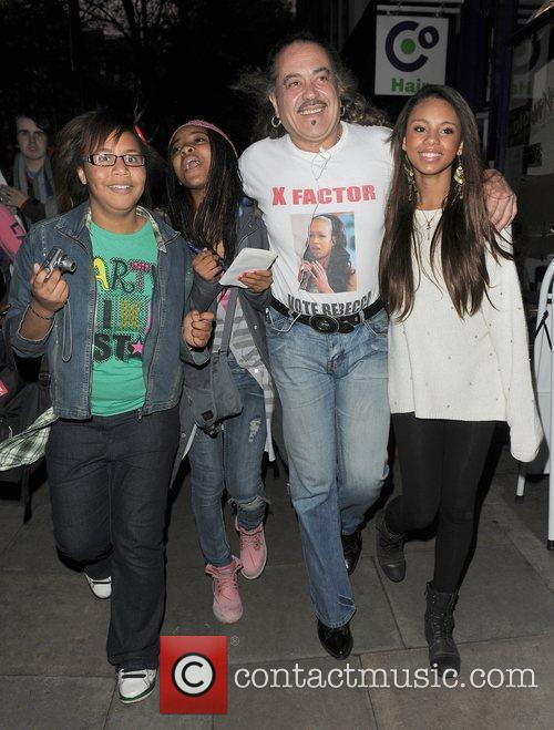 X Factor finalist Wagner Fiuza-Carrilho is mobbed by...
