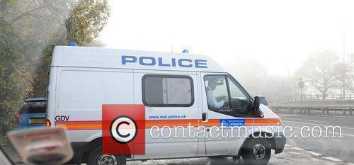 Police leaving the 'X Factor' house after visiting...