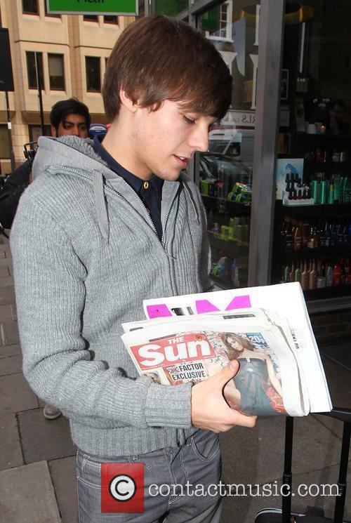 X Factor finalist Louis Tomlinson carrying The Sun...
