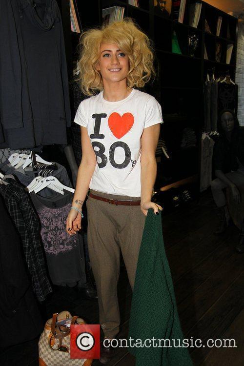 X Factor finalist Katie Waissel  goes shopping...
