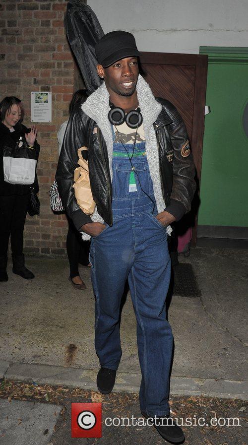 X Factor contestant John Adeleye leaving a studio....