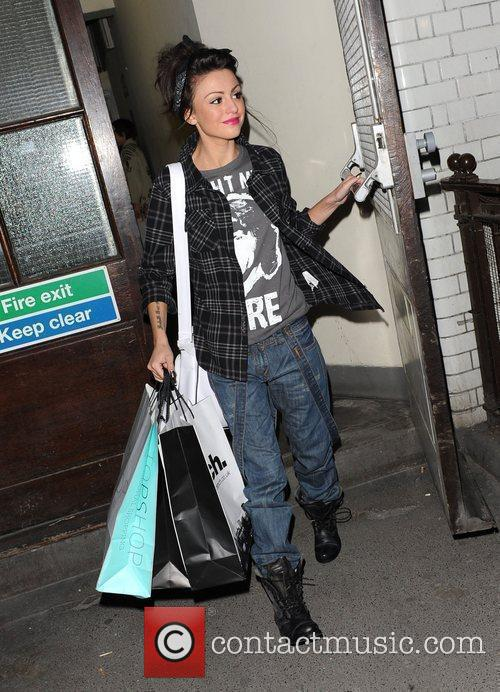 X Factor finalist Cher Lloyd leaving Topshop, having...