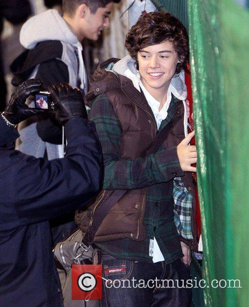 Harry Styles of One Direction,  leaving the...