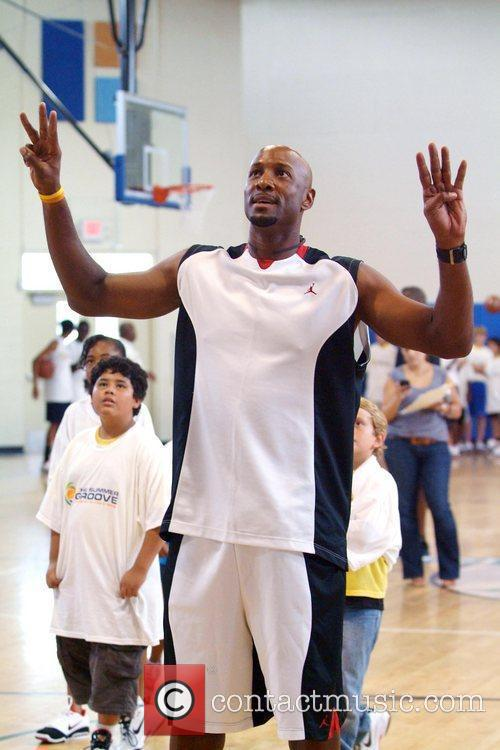 Dwayne Wade and Alonzo Mourning attend the ZSG...