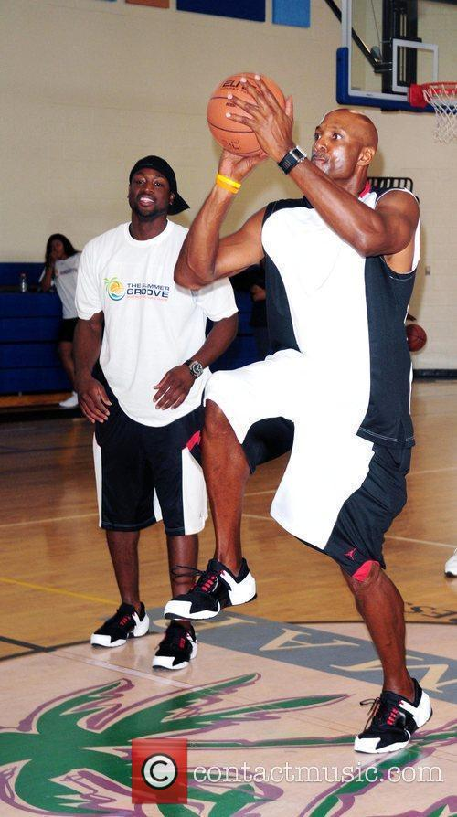 Dwayne Wade and Alonzo Mourning  Dwayne Wade...