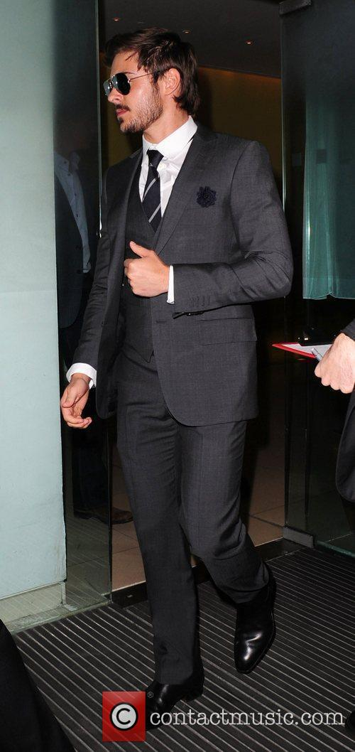 Zac Efron leaving Bungalow 8 in a suit...