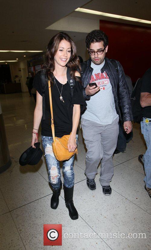 Amanda Crew arrives at LAX on a flight...