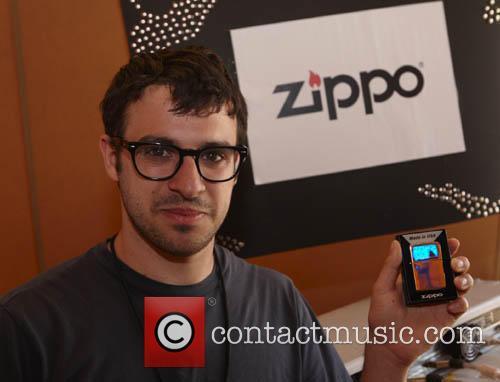 Simon Bird holding a personalised Zippo Windproof Lighter...