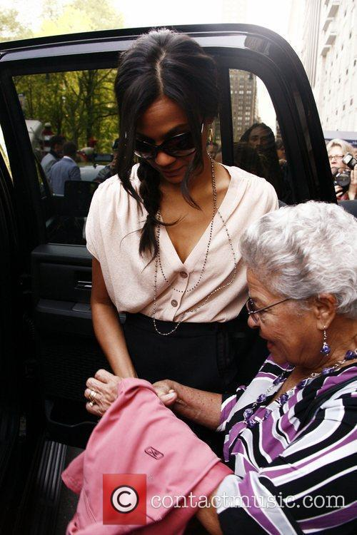 Departs a hotel with her grandmother