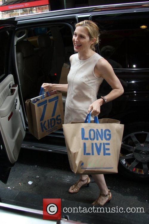 Kelly Rutherford 77kids by American Eagle store opening...