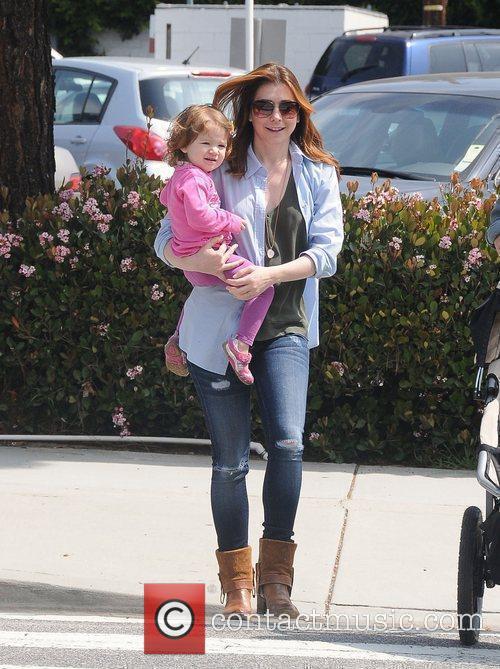 Alyson Hannigan and her daughter Satyana Marie Denisof...