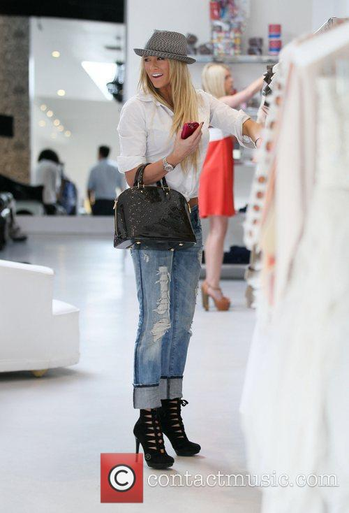 Goes shopping at Alice & Olivia boutique on...