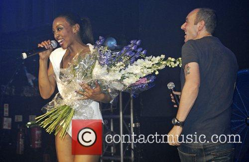 Beverly Knight receives a bouquet of flowers from...