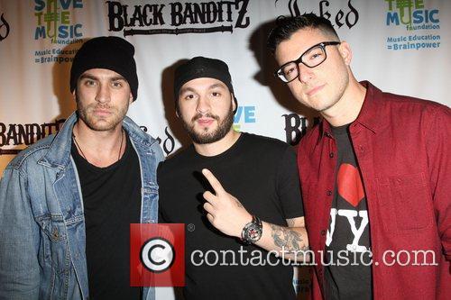 Black Banditz owners Adam Moonves, Dan Regan, and...