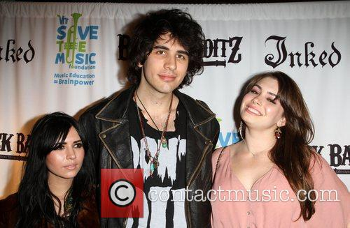 Nick Simmons with his girlfriend (L) and Sophie...