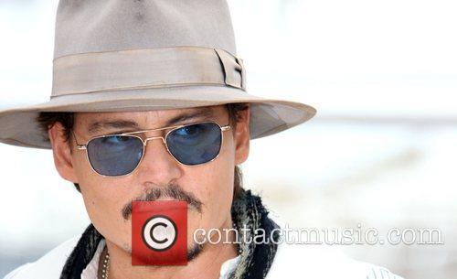 johnny depp tattoos 2011. johnny depp 2011 pictures.