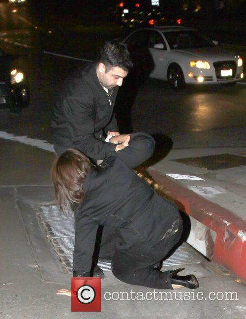 Cheryl Burke's friend falls over outside Chateau Marmont...