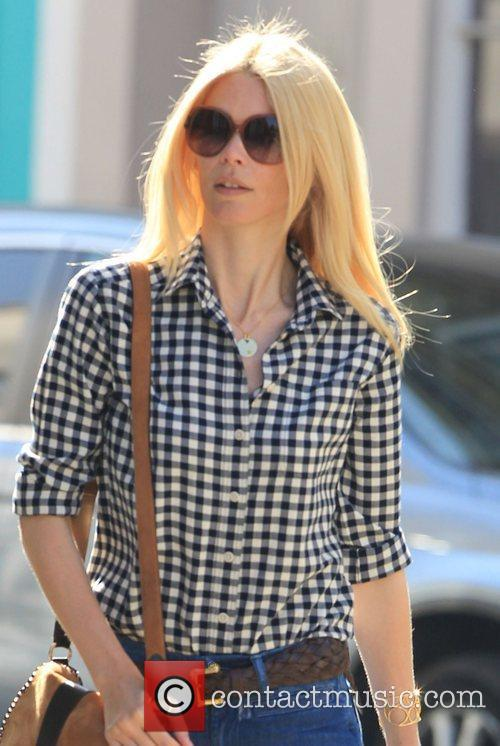 Claudia Schiffer walks away after taking her son...