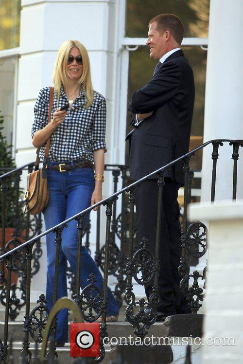Claudia Schiffer chats to a man on the...