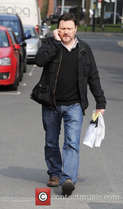 Arriving at the Granada Studios to film Coronation...