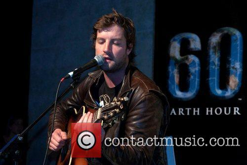 Axel Whitehead Earth Hour 2011, in which major...