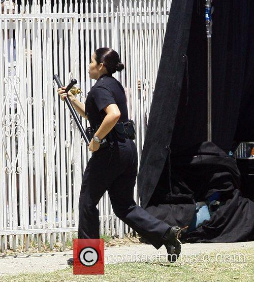 America Ferrera dons a policeman's uniform for her...