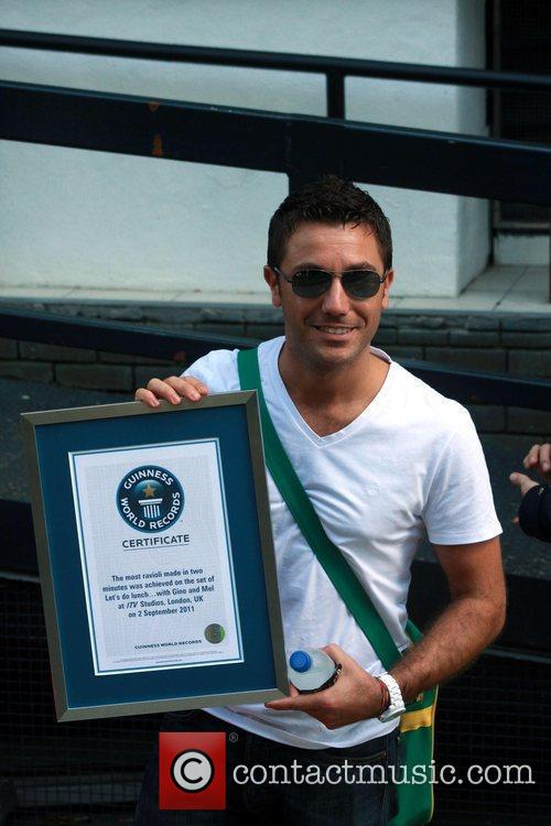 Gino D'Acampo  shows off his Guinness world...