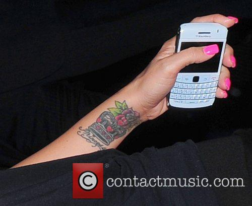 Katie Price showing off her new rose tattoo...